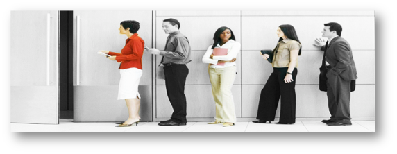 Males and females waiting in line for an interview. Greyed out background and focus on the diverse female candidates