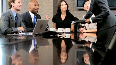 female-business-executive-in-a-boardroom-meeting-with-her-multi-ethnic-business-team