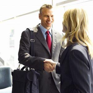 Businessman Shaking Hands with Businesswoman