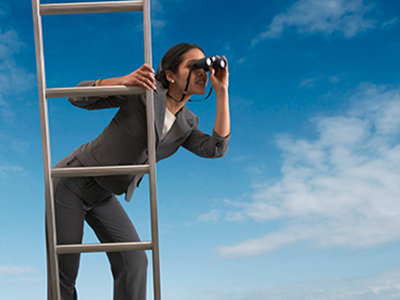 Woman on a ladder searching
