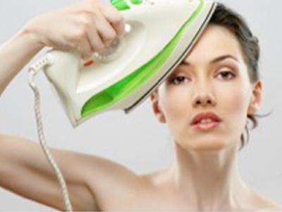 women ironng face featured