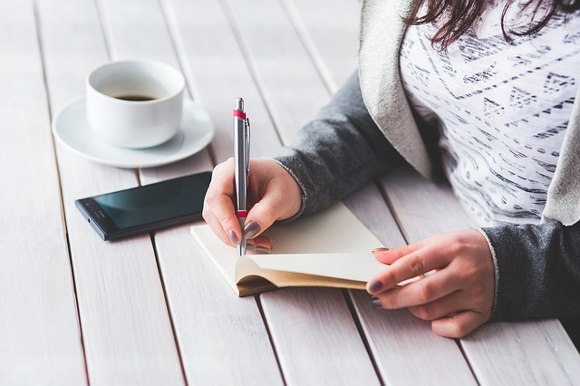 casual woman with coffee and diary, flexible working