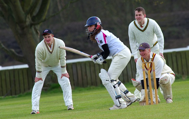 woman playing cricket with men