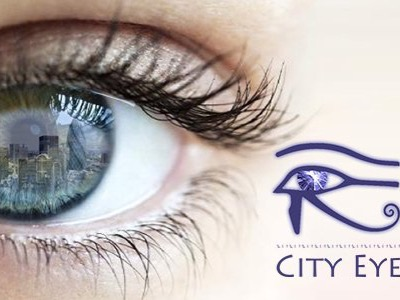 The City Eye Blog Logo - A picture of a woman's eye and the reflection of the London skyline reflected in her eye.