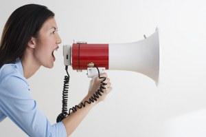 Women shouting into megaphone