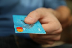 men paying with credit card