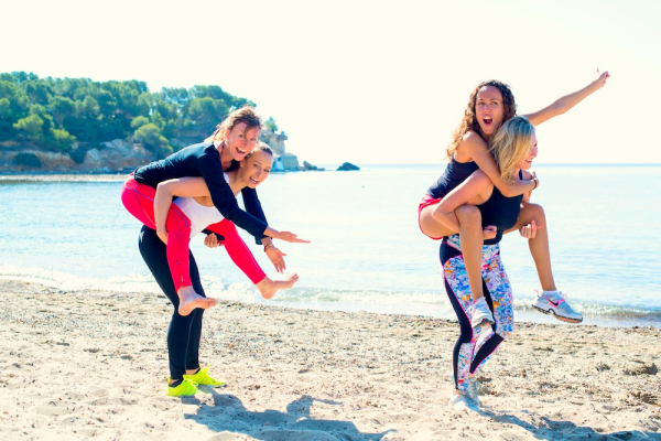 Women giving each other piggy backs on Body:ReSet retreat