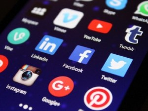Social Media Masterclass - A phone with popular social media apps, such as Twitter, Facebook, Pinterest and Instagram