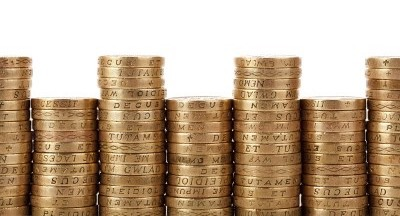 piles of pound coins, gender pay gap