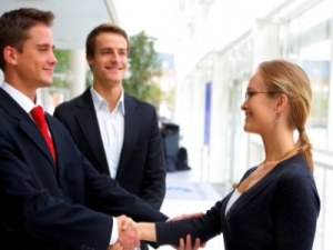 business men shaking womans hand featured - Women Returners