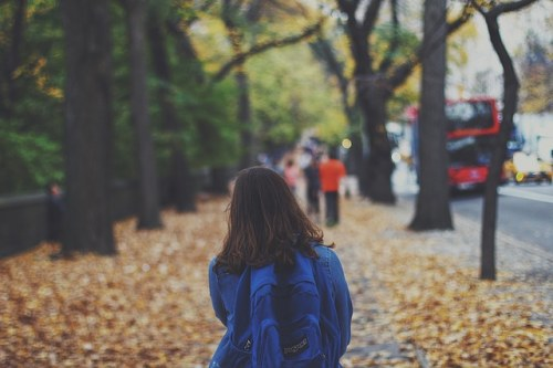 school girl walking down the road