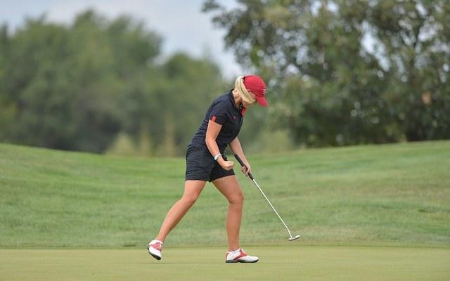 female golfer playing at golf club