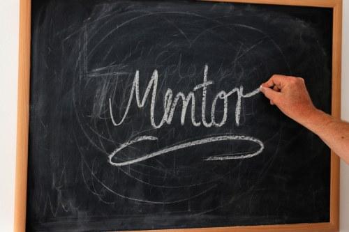 mentor on a chalkboard
