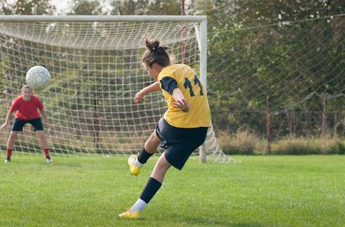 woman playing football, sport