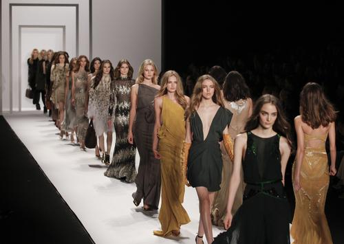 fashion models walking down the catwalk