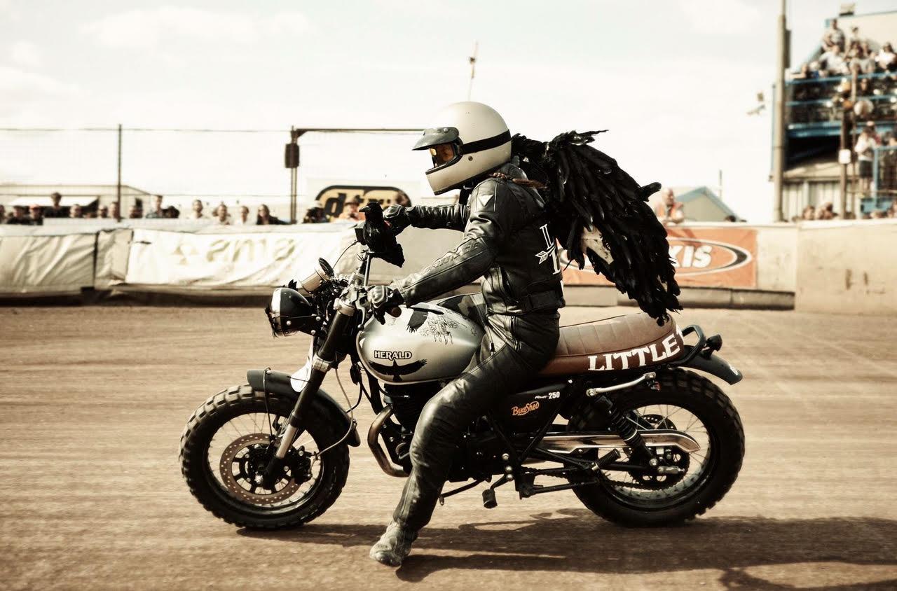 Vikki in black leathers on a motorbike