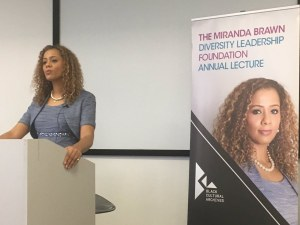 Miranda Brawn speaking at the UK's first diversity lecture on a podium