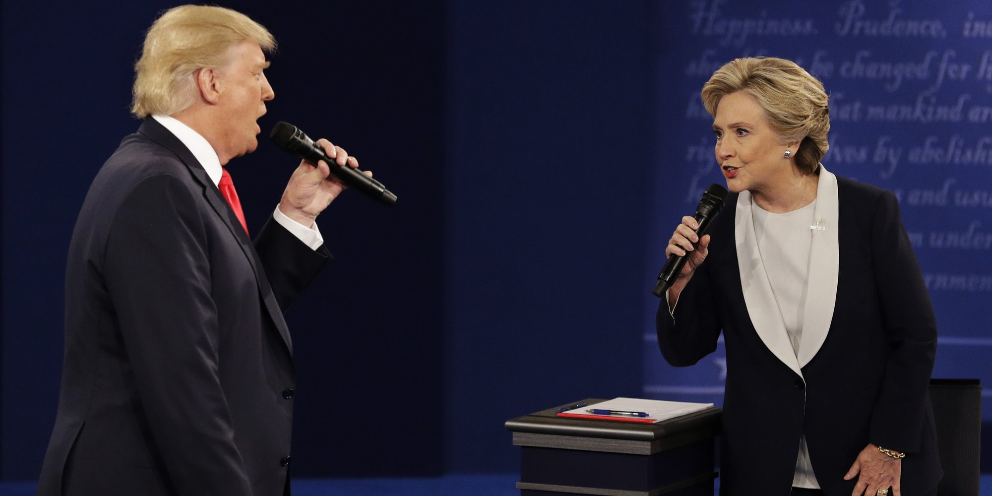 Donald Trump and Hilary Clinton with microphones arguing during the second presidential debate