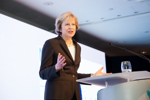 Prime Minister Theresa May tallking on a podium at Women of the Year Lunch Awards