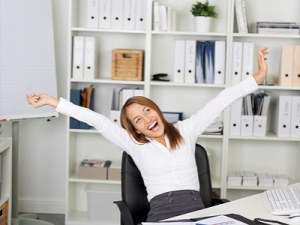 Female Entrepreneur in her office and smiling with arms outstretched