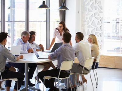 Businesswoman showing leadership skills by leading in a boardroom