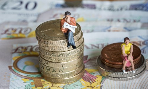 man-and-woman-sat-on-money-piles-gender-pay-gap