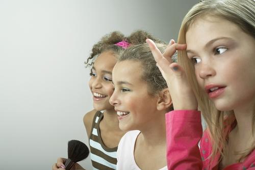 girls fixing their make up, beauty not brains