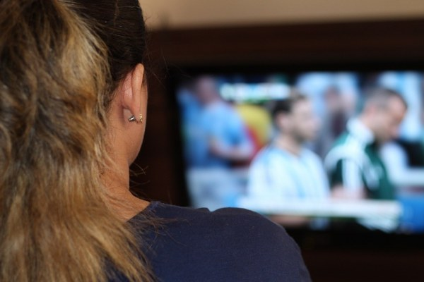 Woman watching TV, distractionsWoman watching TV, distractions