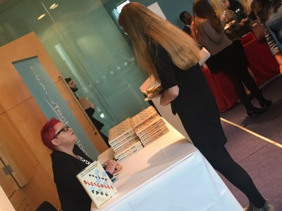 Attendees getting their copies of Saving Bletchley Park signed by author, Dr Sue Black