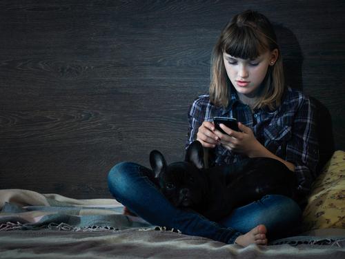 sad child on the phone, childline