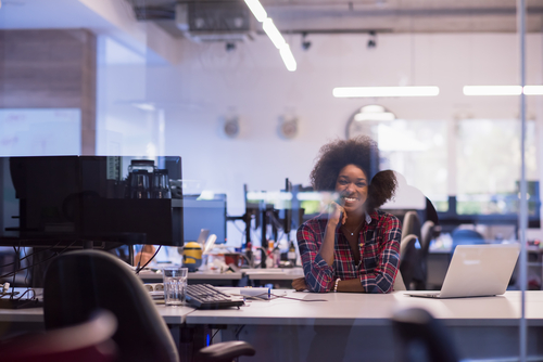 black business woman sitting at her desk