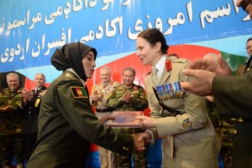 female officer awarding afghan female graduate certificate