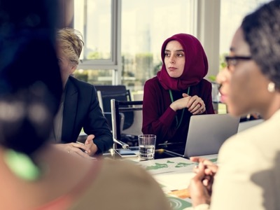 muslim lady wearing a headscarf at board meeting featured