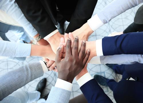 team holding hands, mental health