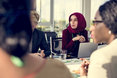 muslim lady wearing a headscarf at board meeting