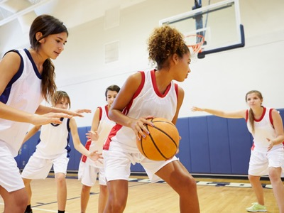 girls playing sport featured